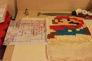 A cake designed from a bitmap graphic of Mario.